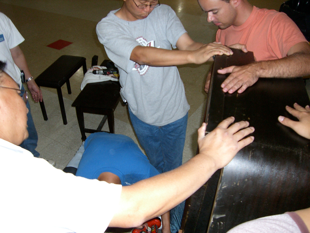 Songju prepares to carry the piano on his back