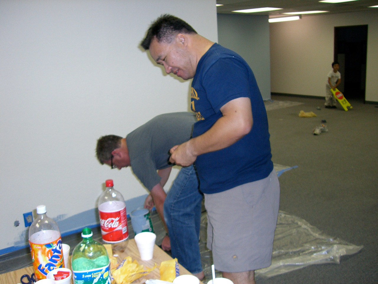 People painting the fellowship hall & The Coke calls out to Pastor Pall