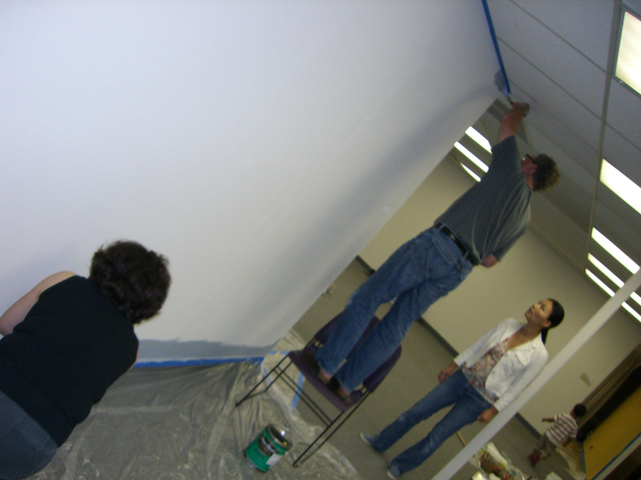 People painting the fellowship hall