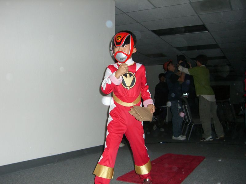 Red Power Ranger Jacob Lee on the catwalk