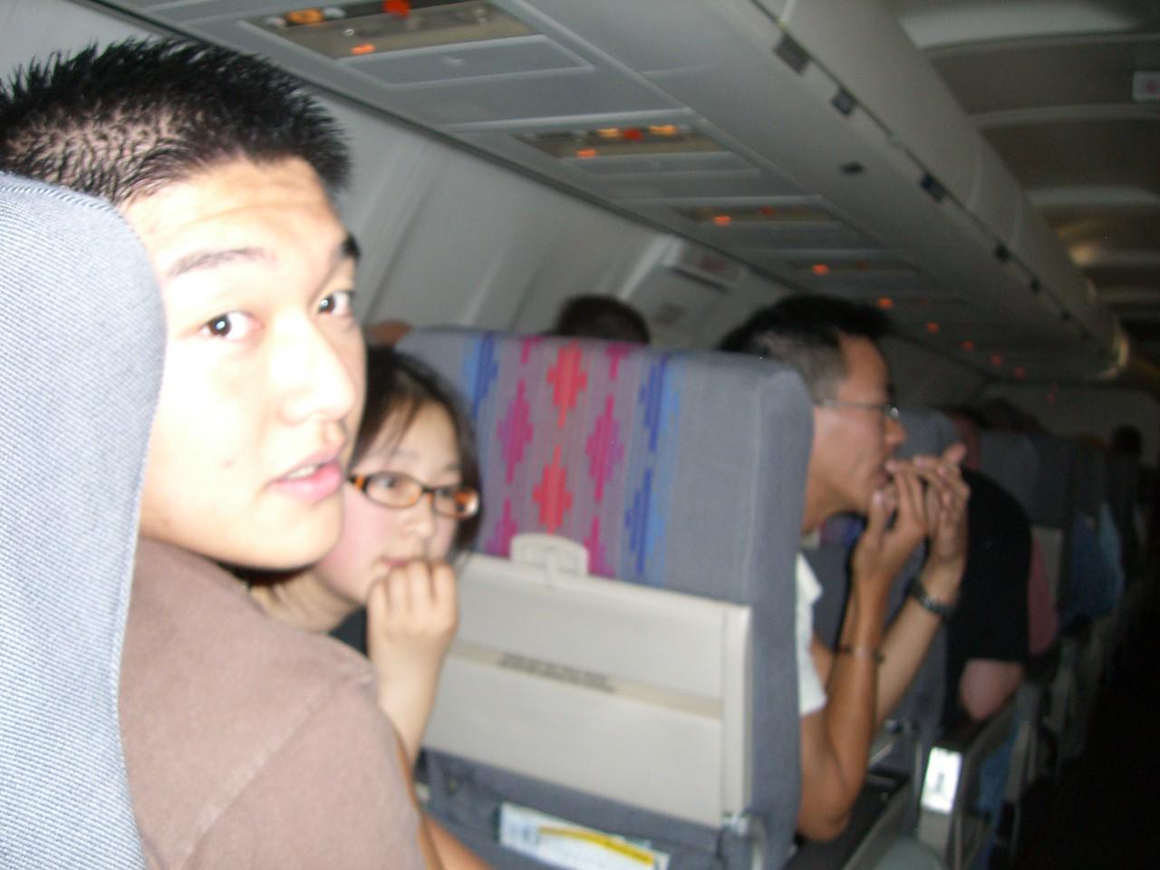 2006 07 12 Wed - Dan Tung, Angela Hsu, & Ben Yu on the plane
