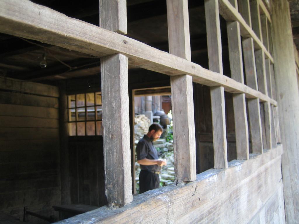 2006 07 30 Sun - Miao village - Bob Savage through old schoolhouse classroom window