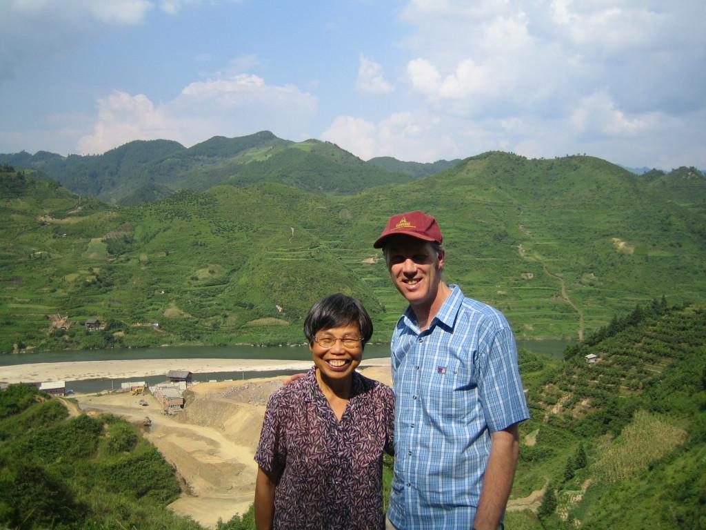 2006 07 30 Sun - Miao village - Lai-Yee Hom & Phil Arnold overlooking site of new Jian He high school