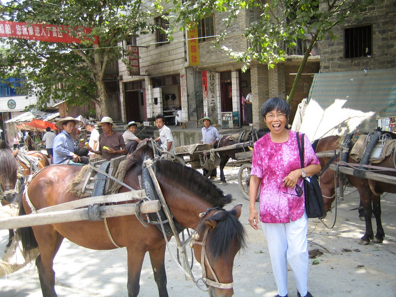 2006 08 01 Tue - Lai-Yee Hom caught with a horse