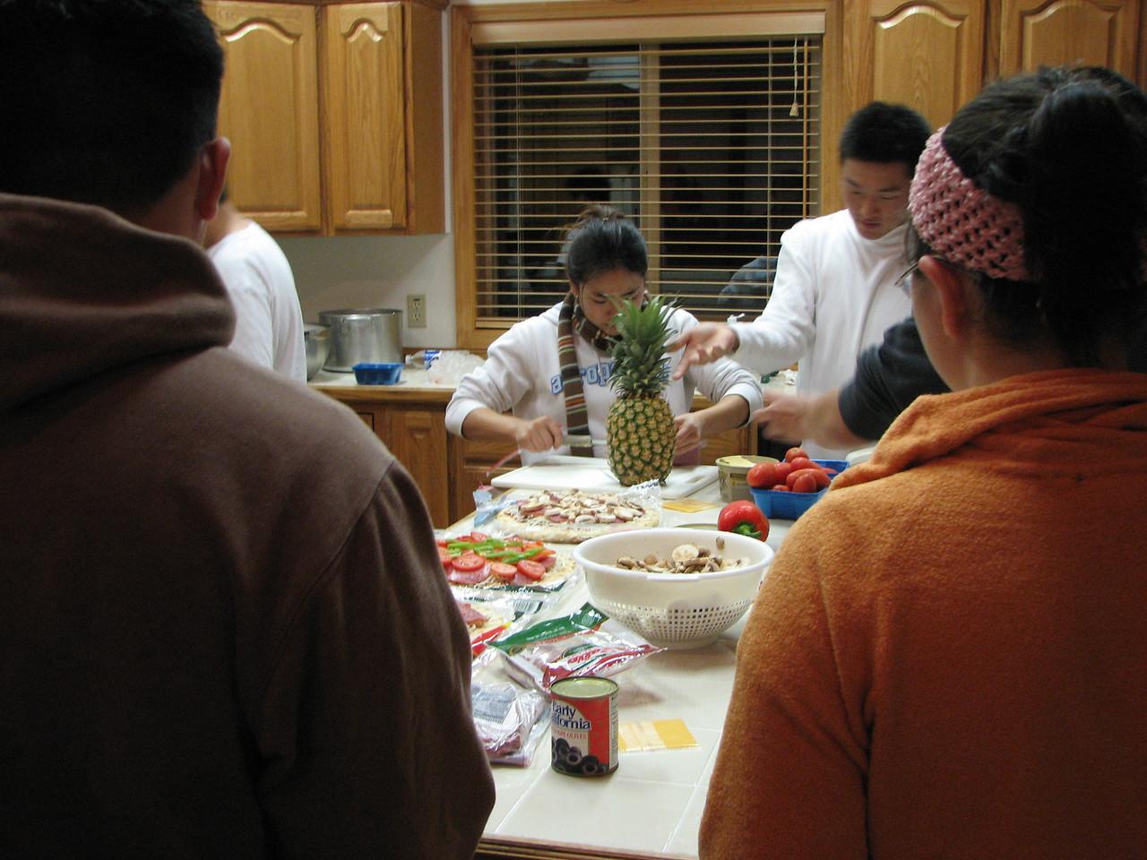 2006 12 21 Thu - Shinae Kim & Ted Hong preparing pizzas