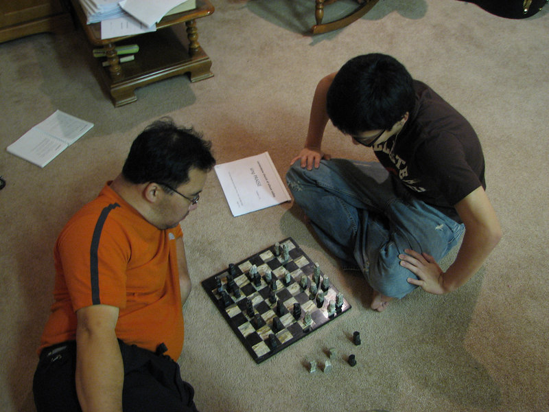2006 12 22 Fri - Pastor Paul & Jimmy Lee play chess