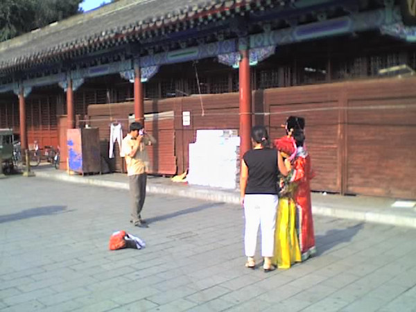 2006 08 15 Tue - Sad commercialized square in front of the Forbidden City 2 - emporer & emporess costumes for photo opps 1