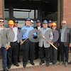 Drew Zimmerman – dzimmerman@shawmedia.com<br /> DeKalb officials and developers stand near First Street and Lincoln Highway, the site of the $7.5 million Cornerstone apartment and commercial use complex. Pictured are Foti Pappas (from left), 2nd Ward Alderman Bill Finucane, 6th Ward Alderman Mike Verbic, Mayor Jerry Smith, former 4th Ward Alderman Bob Snow, 4th Ward Alderman Patrick Fagan, former Mayor John Rey, 7th Ward Alderman Tony Faivre, 5th Ward Alderwoman Kate Noreiko, John Pappas and Spiro Pappas. John Pappas, the principal developer, said demolition for the project is expected to begin sometime this month.