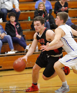 Corning High's Brendan Hoag drives towards with basket with strong pressure from Orland's Foster Wyatt on the first night of the Herb Jergentz Basketball Tournament December 1, 2016 at Durham High School in Durham, California. (Emily Bertolino -- Enterprise-Record)