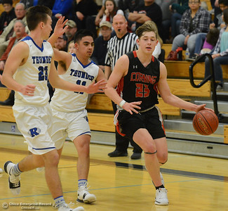 Corning High's Noah Zoppi races down court as Rocklin High's Adam Syed (11) and Cory Gohl (23) play defense in the annual McDonald's Winter Classic Saturday December 9, 2017 at Pleasant Valley in Chico, California. (Emily Bertolino -- Enterprise-Record