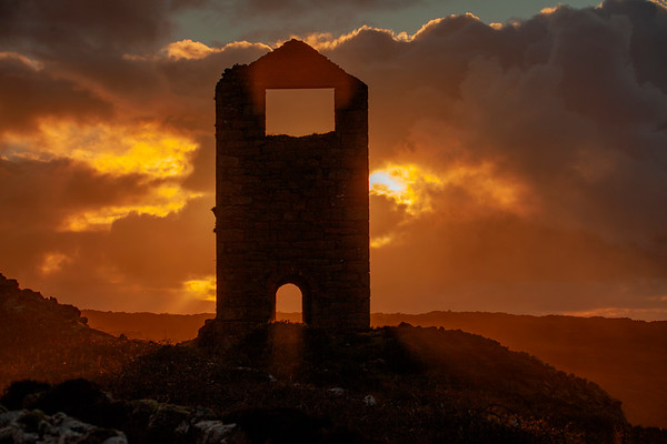 Sunset behind an old tin mine engine house at Botallack