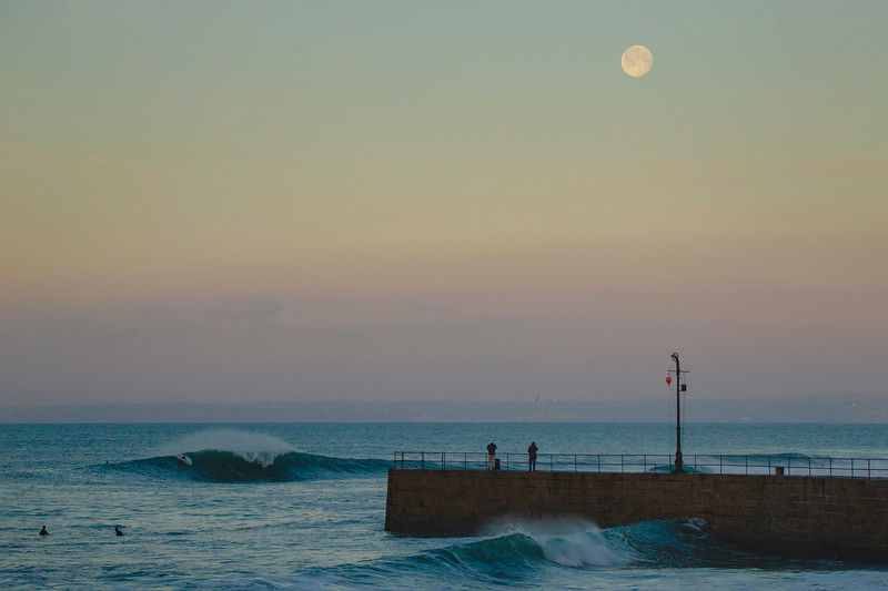 The Snow Moon above Porthleven pier