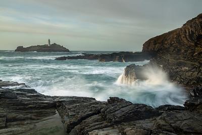 Godrevy lighthouse with crashing waves