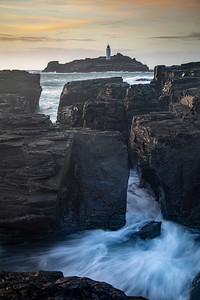 Godrevy lighthouse between the rocks