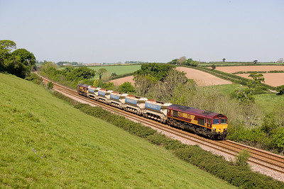 030507 66025 TnT with 66163 with the 1000 Goonbarrow-Westbury is seen between Trerulefoot and St Gemans