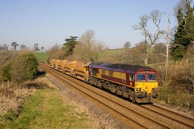 66117 heads 0840 Penz-Westbury empty ballast train near bethany