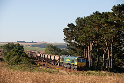 240706  66550 on the N Abbot-Burngullow empty sand working passes Trerulefoot.The wagons will be loaded and tripped back in two sections