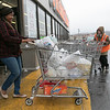 Many are rushing to the supermarkets to stock up during the coronavirus emergency on Friday, March 13, 2020. Elvin Kaninjing at the Market Basket on John Fitch in Fitchburg. SENTINEL & ENTERPRISE/JOHN LOVE