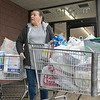 Many are rushing to the supermarkets to stock up during the coronavirus emergency on Friday, March 13, 2020. Carolyn Cormier at the Market Basket on John Fitch in Fitchburg with two carts full of food and supplies. SENTINEL & ENTERPRISE/JOHN LOVE