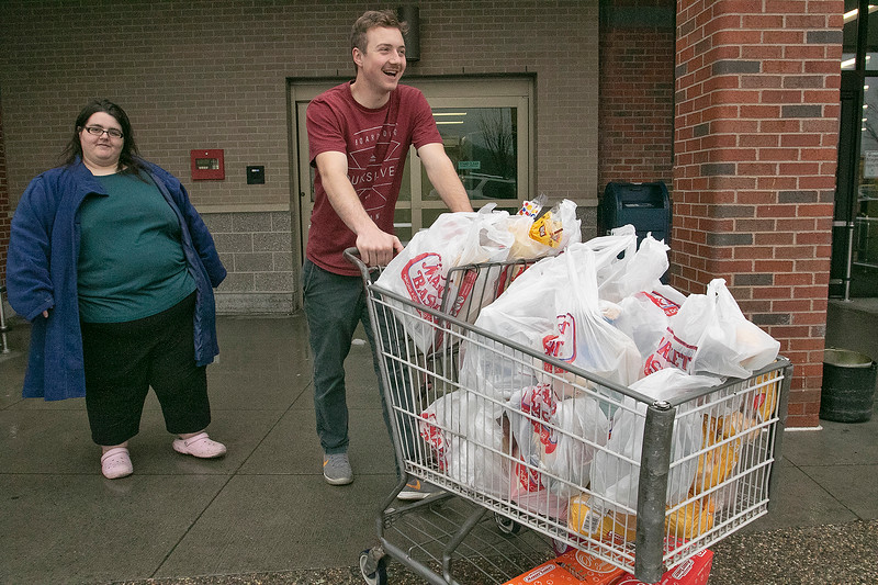 Many are rushing to the supermarkets to stock up during the coronavirus emergency on Friday, March 13, 2020. Dan Wagner and Ashleigh Tyues at the Market Basket in Leomimnster. SENTINEL & ENTERPRISE/JOHN LOVE