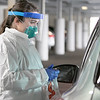 UMass Memorial HealthAlliance-Clinton Hospital in Leominster has set up a tent outside in the parking garage to test for the coronavirus. This is a test only after you have talked to your primary care physician and they given you a note to have the test done. RN Stephanie DiPommaso gets ready to take a sample from a patient on the first day of the testing Friday, March 20, 2020. SENTINEL & ENTERPRISE/JOHN LIOVE