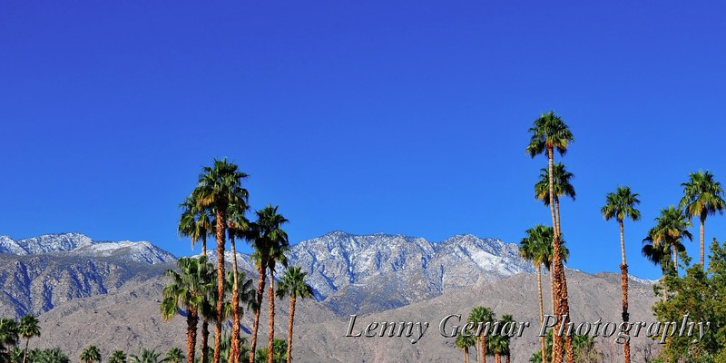 Snow-capped mountains overlook our arrival in the Coachella Valley as we land at PSP (Palm Springs airport)