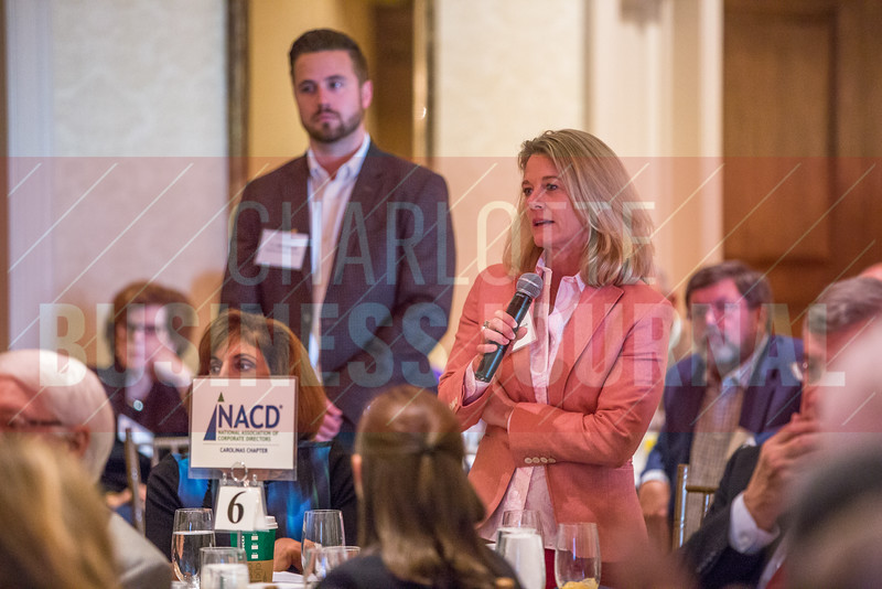 Audience members participate in a Q&A session with the panelists at the Corporate Governance Breakfast, held at Quail Hollow Country Club.