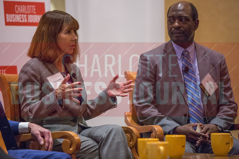Laura Shulte, Novant Health Board Member (left), and Stick Williams, Carolinas Healthcare System Board Member (right), participate in a panel discussion at the Corporate Governance Breakfast, held at Quail Hollow Country Club.