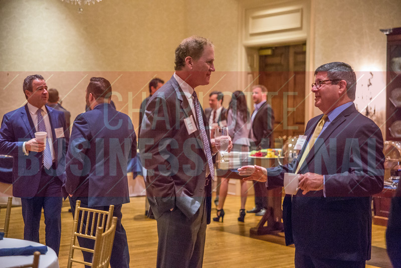 Attendees of the Corporate Governance Breakfast, held at Quail Hollow Country Club, mingle and network before the event begins.