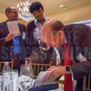 Moderator Peter Browning, Founder/Man. Director, Peter Browning Partners/Equilar Board Member, autographs copies of his book as the request of attendees of the Corporate Governance Breakfast, held at Quail Hollow Country Club.