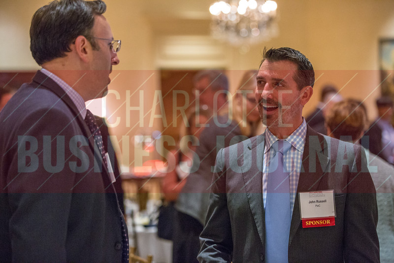 Attendees of the Corporate Governance Breakfast, held at Quail Hollow Country Club, mingle and network after the event.