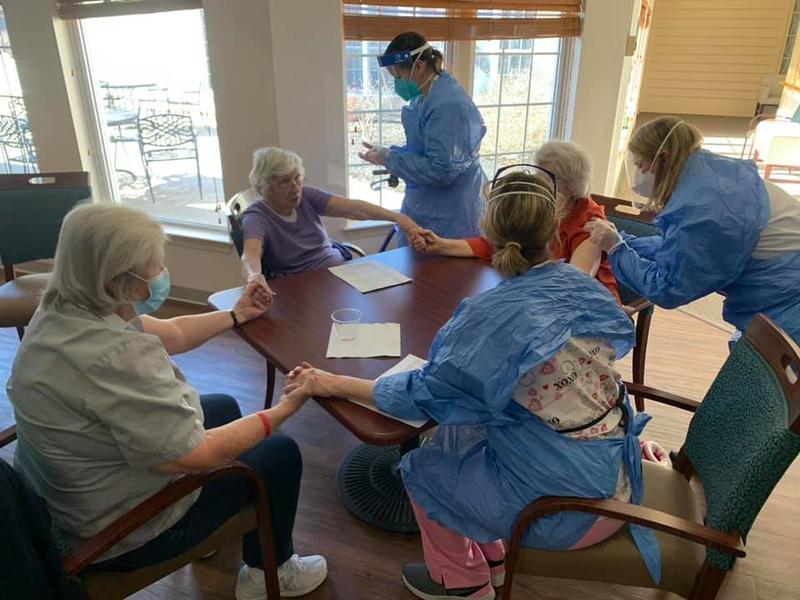 CVS pharmacists giving Aspen residents vaccine