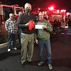 John Hendrickson presenting check to fire chief