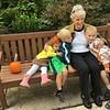 Evelyn Lester with grandchildren on bench