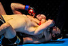 Baron Hollowell (bottom), in his debut fight, quickly submits Tyler Roche (top) at 2:12 in the first round, with a rear naked choke at the Davis Conference Center in Layton on Saturday, November 17, 2012. (ROBBY LLOYD/Special to the Standard-Examiner)