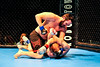 Ryan Lund (top) of Ogden overpowers Christine Ritter (bottom) on his way to a quick victory by submission at 2:14 in the first round at the Davis Conference Center in Layton on Saturday, November 17, 2012. (ROBBY LLOYD/Special to the Standard-Examiner)
