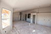 """The interior of a home's future kitchen and dining room in """"The Plaza"""" housing development in Farr West on October 24, 2014."""