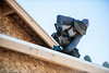 """Oscar Jasso works on the roof of a house under construction in """"The Plaza"""" housing development in Farr West on October 24, 2014."""