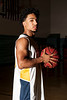 """Kobe Beatty, starting point guard for the Bonneville Lakers poses for a photo in the gym of Bonneville High School on February 7, 2015. Beatty was named after iconic LA Laker Kobe Bryant, but at his height of 5' 6"""" he has adapted a much different style of play."""