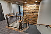 Re-purposed barn wood was used at both first and second floors of this stairwell.