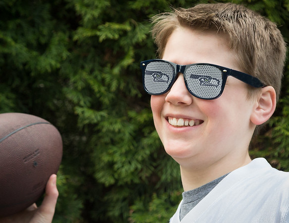 Seattle Seahawks sunglasses on young football player.