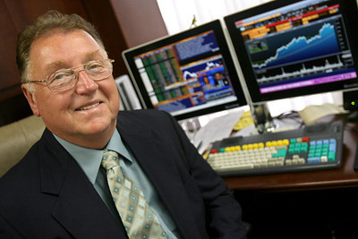 R. Saxon Birdsong, president and director of investments with Baltimore-Washington Financial Advisors, Inc., sits in his Columbia office on Thursday, June 14, 2007. Chris Ammann/Examiner