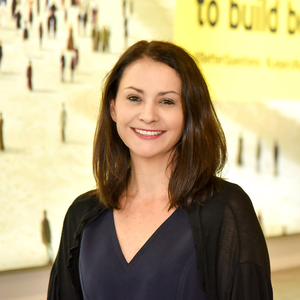 Successful businesswoman in transaction services warm toned portrait