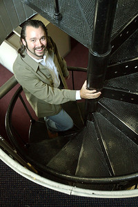 Brendan Cooke, a realtor/assistant broker with RE/MAX Firehouse Realty, stands in the metal spiral staircase of their offices inside the old firehouse of Baltimore City Fire  Co. 156 (used from 1910 - 1989) in Baltimore on Tuesday, July 31, 2007. Chris Ammann/Examiner