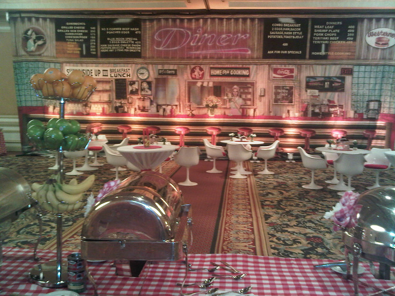 A 50's themed Diner Party with Breakfast Food in the ballroom at Belmond Charleston Place.  Designed by JMC Charleston, an event production and destination management company located in Charleston, South Carolina.