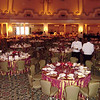 Very simple lighting on our part, linens, flowers, base plates, napkin rings and elegant corkscrew cypress plants made for a nice accent to this famous ballroom.