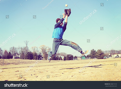 stock-photo-boy-catching-a-baseball-sandlot-baseball-focus-on-shirt-396811513