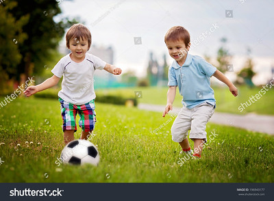 stock-photo-two-cute-little-boys-playing-football-196943177