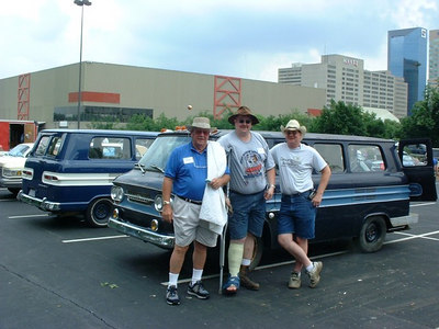 That's me in the middle with the crutch. Chuck Armer is on the left, and Ken Hand is on the right. That's my 63 Greenbrier behind us. Note the fog lights, cab marker lights, and wrap-around rear bumper. Yes, the van only comes up to my shoulders. This picture was taken in June 2004 in Lexington, KY at the Corvair Convention.