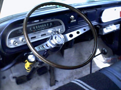 Here's a 64 Chevelle wood steering wheel on my 63 Greenbrier. I also had a vintage flashlight holder on the steering column, and a generic tissue dispenser in that van, but they've long since found other homes... but the steering wheel is still on it.
